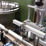 Botilako betetze automatiko kimikoa estaltzeko makina